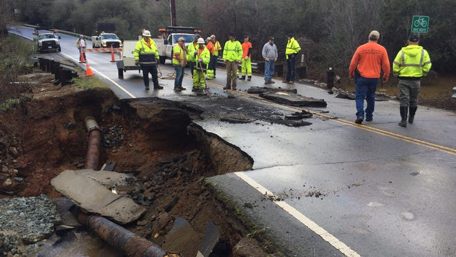 Flooding in Sulphur Creek eroded the ground underneath Keswick Dam Road Monday, leading to its closure for some time.