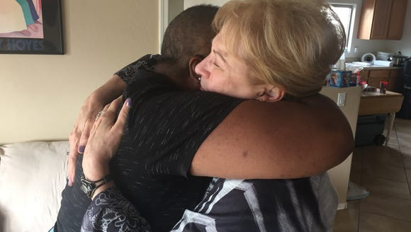 Donna McHenry and Lois Hampton embrace in the McHenry's