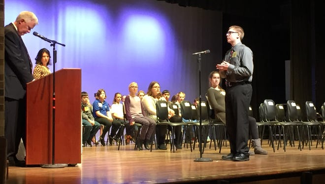 Jordon Fite, of Woodmore Elementary School, concentrates as he tackles another word during the final round of the Ottawa County Spelling Bee on Tuesday.