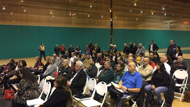 The Airmont Village Board mets Wednesday night on the basketball courts inside Rockland Community College's Eugene Levy Fieldhouse. The board passed a building moratorium and a year-round overnight parking ban.