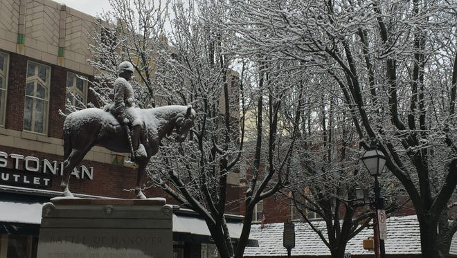 The Battle of Hanover statute in the square covered in snow on a Thursday morning this winter.
