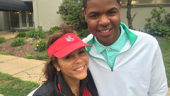 Charma Bell, the program director at The First Tee of Delaware, with Earl Cooper, a certified PGA professional and former student in The First Tee programs.