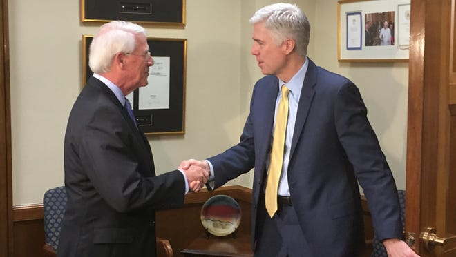 Sen. Roger Wicker, left, greets Supreme Court nominee Neil Gorsuch Friday.
