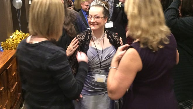 Volunteers put a tiara as a guest enters Night to Shine a special needs prom event held Friday night at Hotel Marshfield.