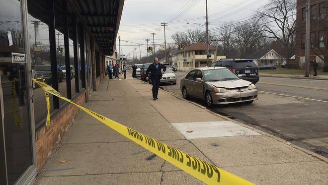 Lansing police on the scene of a shooting on East Kalamazoo Street in Lansing Saturday, Feb. 11, 2017.