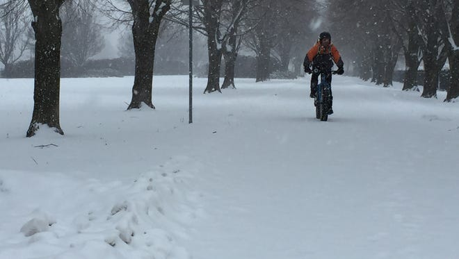 Jeremy Kehoe of Burlington rides his fat bike at Waterfront Park on Sunday afternoon.