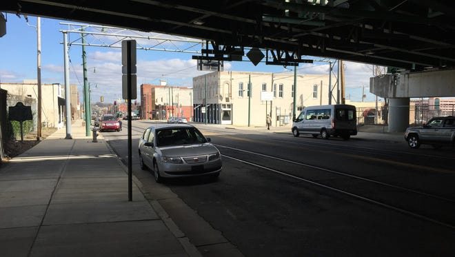 Downtown board has approved up to $200,000 for public art and lighting to spruce up Main Street where it passes beneath Interstate 40.