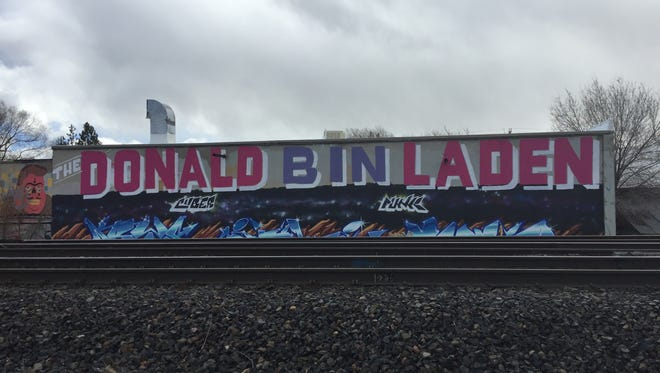 The Donald bin Laden has been painted on the back of a building located on Dickerson Road. The painting is visible from Fourth Street.
