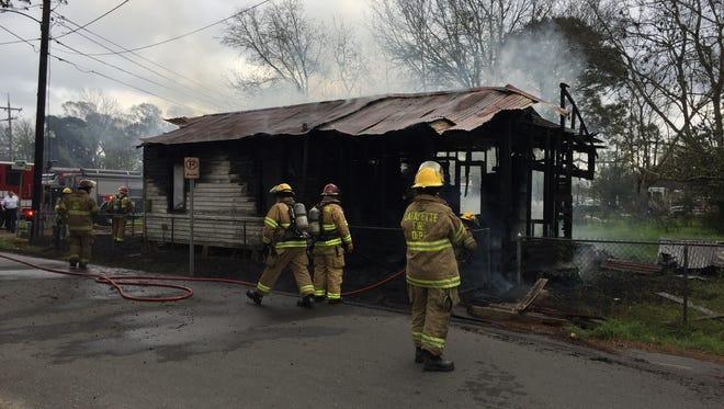 Firefighters battle a blaze on Morgan Street Monday morning.