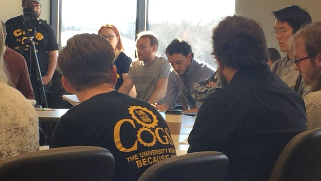 Members of the Campaign to Organize Graduate Students, UE Local 896, present their initial contract proposal Tuesday to the bargaining team for the Iowa Board of Regents.