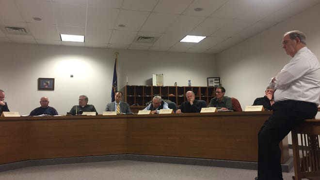 Ron Smeal, right, talks with Southern Police Commission members Tuesday night while presenting the findings of his study into Southern Regional Police. Recent disagreements over a police formula that determines who pays for what have led to an impasse between commission members as two municipalities have also submitted letters of intent to withdraw.