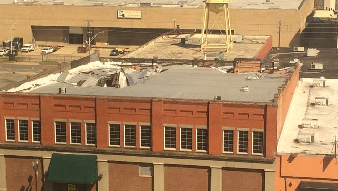The collapsing roof of the former Goode-Cage Drug Store building at 401 Spring Street