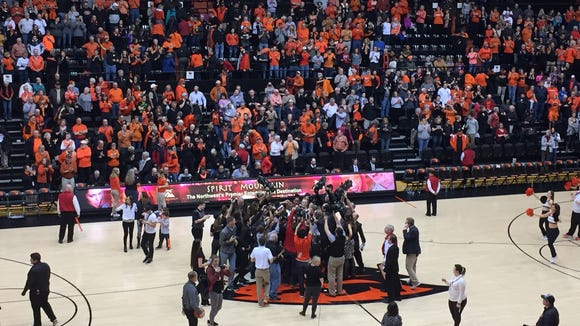 The Oregon State women's basketball team gathers at midcourt to celebrate a 50-47 victory over Stanford at Gill Coliseum on Feb. 24, 2017.