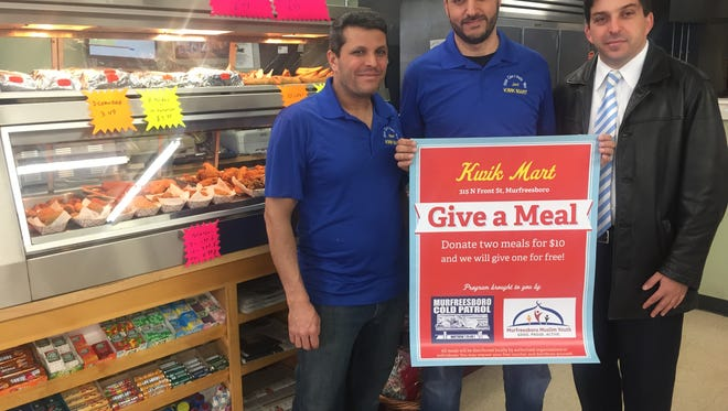 Kwik Mart owners Mahmoud Ismail, left, and Jad Hasan, center, stand with community partner Abdou Kattih with the Murfreesboro Muslim Youth. The men have partnered with Murfreesboro Cold Patrol, a Christian organization, to offer free food to those in need. For just $10 you can provide three meals to the hungry.