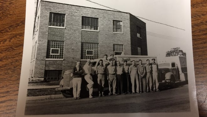 Parkin Ice Cream Company employees stand outside the Parkin Building in downtown Marshfield. The photo was provided by the North Wood County Historical Society.
