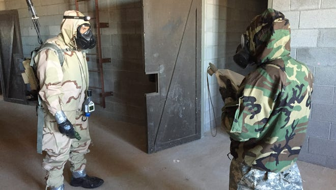 Soldiers with the 22nd Chemical, Biological, Radiological and Nuclear Battalion go room to room looking for potential threats.