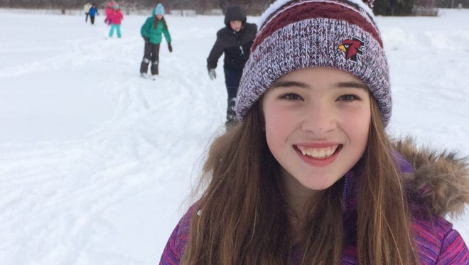 Cora Duehring, one of the students who learned to ski with Dr. Oliver Clements, smiles during the experience.