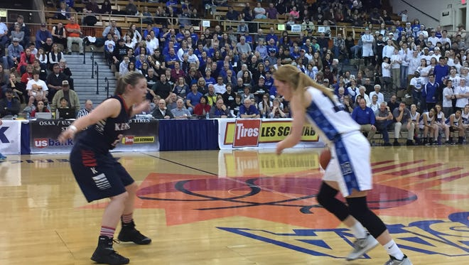 Western Mennonite's Madison Hull, right, scored 35 points in Friday's 52-37 victory over Kennedy in the 2A girls state semifinals.