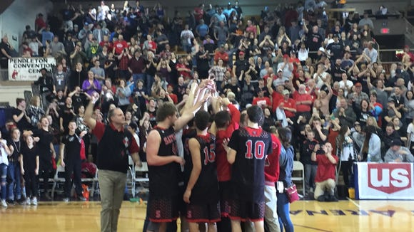 Santiam celebrates its OSAA Class 2A state championship at Pendleton Convention Center on March 4, 2017.