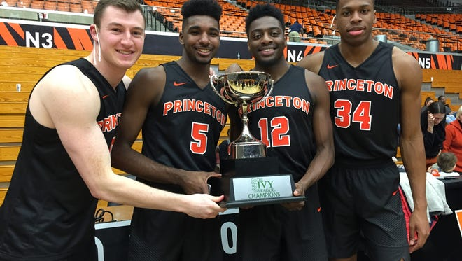 Princeton's Jersey guys, left to right, hold the Ivy League trophy: Spencer Weisz (Seton Hall Prep), Amir Bell (East Brunswick), Myles Stephens (Lawrenceville) and Richmond Aririguzoh.