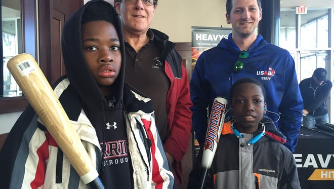 At the equipment exchange: Asbury Park Little League president Danny McKee (back left), USABL officer Brian Schifilliti (back right), 13-year-old Xavier Chathuant (front left) and 11-year-old Shakim Patterson (front right).