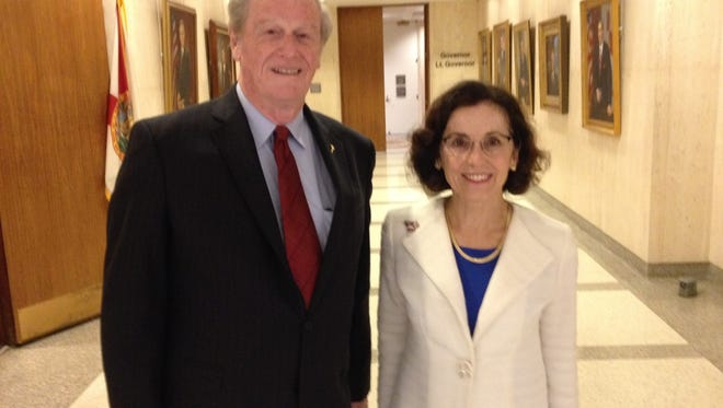 FSU President John Thrasher, left, and France Cordova, director of the National Science Foundation, pose for a picture following their Tuesday morning meeting with Gov. Rick Scott at the Capitol.