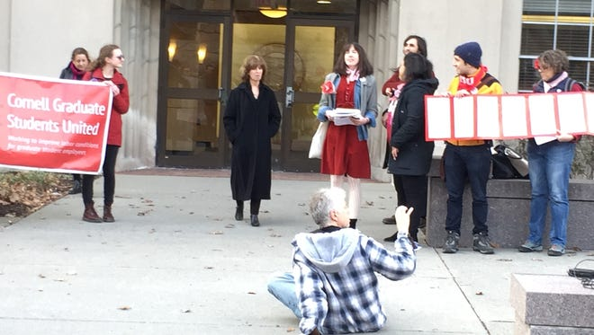 Michaela Brangan delivered a petition for graduate student workers to become unionized to Mary Opperman,Cornell University vice president and chief human resource officer.
