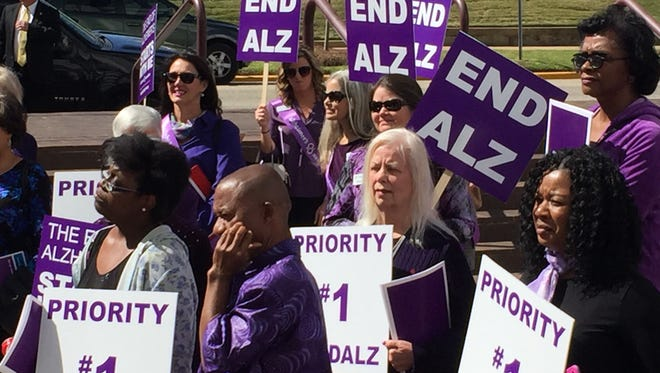 Caregivers and family members of those diagnosed with Alzheimer's, rally outside the Alabama State House on Wednesday, March 8, 2017, to bring to light HB 310, which would require training for First Responders who come into contact with those diagnosed with the disease.
