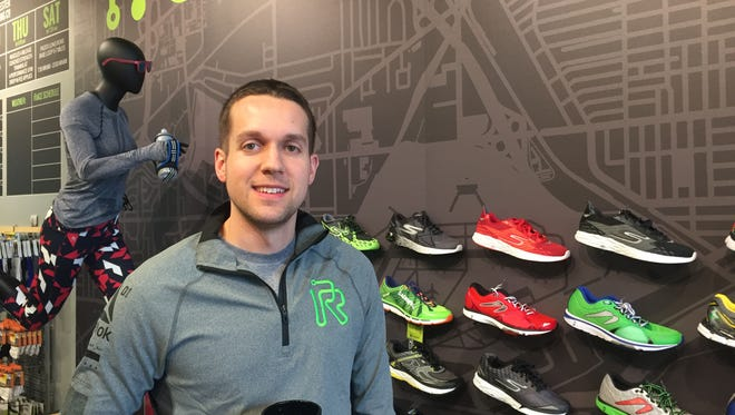 Rochester firefighter Jonathan Griffiths, 32, inside his Rochester Running Company store in College Town. He's running in the Los Angeles Marathon on March 19.