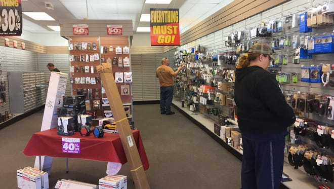 A few customers look for some deals at Radio Shack on Wednesday morning. The store is closing its doors by Sunday.