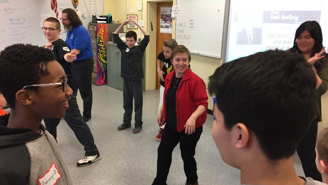 Dancer Laura Marchese, center, leads teacher Darrell Sandrue's (rear, blue shirt) seventh grade class through a dance exercise to complement a language arts lesson at Netcong Elementary School on Tuesday, March 7, 2017.