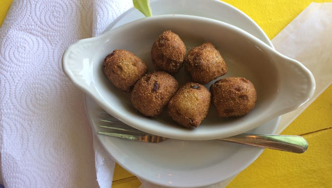 In addition to the house-smoked Wahoo dip, the jalapeño hushpuppies are a local favorite.