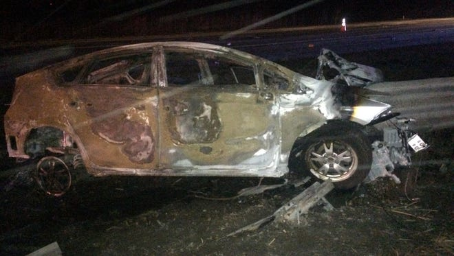 A 39-year-old woman survived a crash in which her car burned after being impaled by a guardrail in Delhi Township on March 13, 2017.