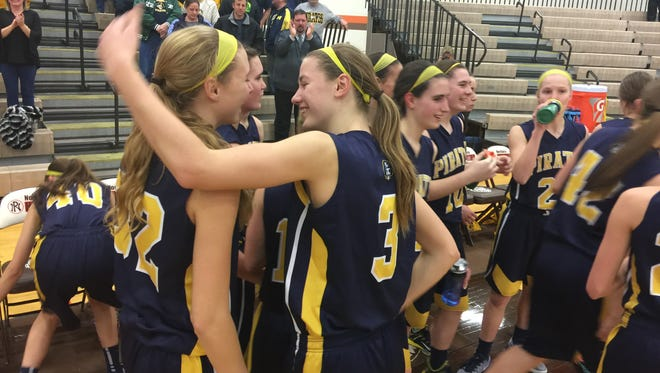 Emily Spitzley, left, and Hannah Spitzley (3) celebrate following Pewamo-Westphalia's 43-19 victory over Schoolcraft in a Class C quarterfinal Tuesday.