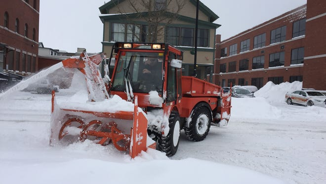 A sidewalk plow, colloquially known as the BTV Snow Dragon, clears pedestrian pathways at the corner of Pearl and Elmwood around noon on Wednesday, March 15 as the city begins to dig out after Winter Storm Stella