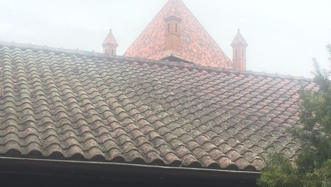The Cathedral of All Souls replaced roofing tiles on the church building, a $1.5 million project, in 2016. It has not replaced tiles on the remainder of its building, in part because of the expense.