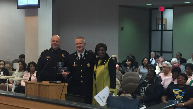 Shreveport Fire Chief Scott Wolverton (middle), flanked by State Fire Marshal Butch Browning (left) and Mayor Ollie Tyler (right),who announced Shreveport received the Louisiana Fire Department of the Year award