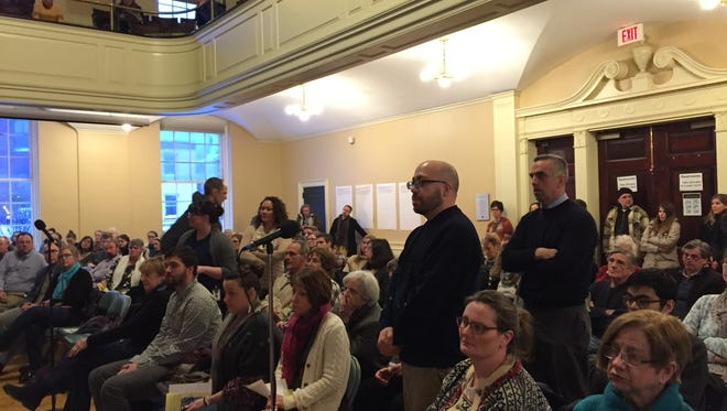 People line up to ask questions at an opioid town hall in Burlington VT