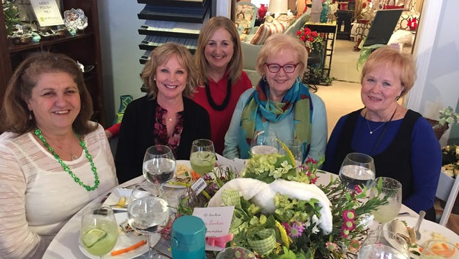 Spring luncheon BJ's Home Accents was the scene of a sweet luncheon recently as an opportunity for event planner Nancy Bennett to share some ideas for spring and Easter decorating. Guests enjoyed a lunch catered by Just Rennie's and began the idea sharing with learning to fold a napkin in the shape of a bunny. In the photo are Helen Sheets, Karen Reynolds, Nancy Bennett, Beverly Leslie and Joyce Mohler.