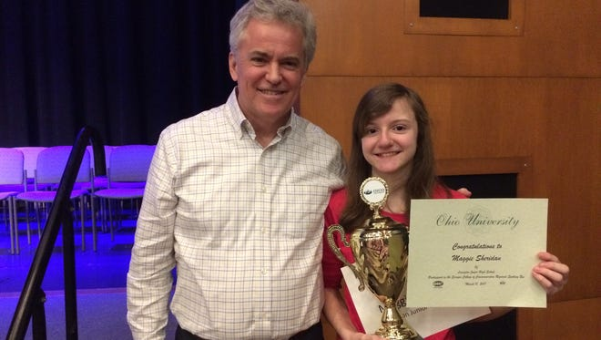 Lexington seventh-grader Maggie Sheridan poses with her father, Mark Sheridan, after winning the Regional Spelling Bee at Ohio University on Saturday, March 18, 2017. Sheridan qualified for the Scripps National Spelling Bee in May.