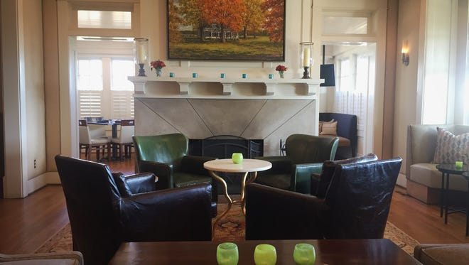 A new living room setting is located in the entryway of Corbett's An American Place.