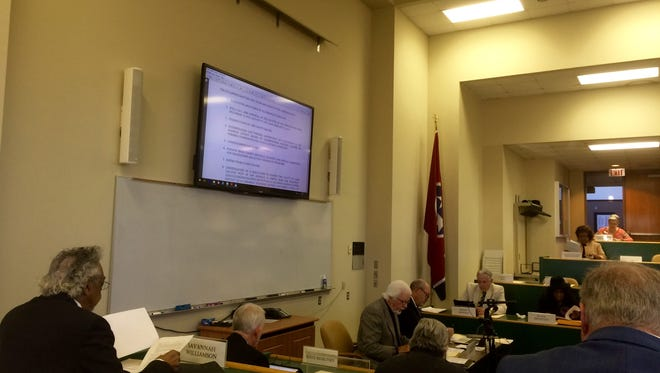 The Madison County Board of Commissioners discuss business at its monthly meeting Monday.