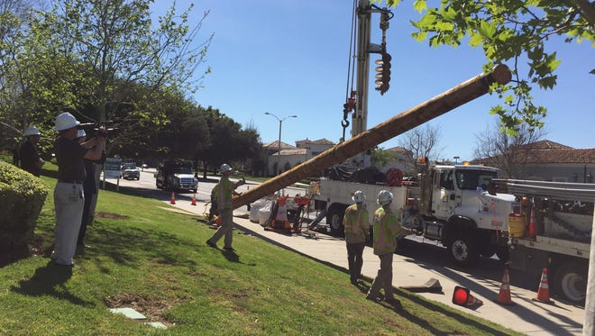 The last of 53 Thousand Oaks Boulevard utility poles was taken down by Southern California Edison last week as part of a city effort to beautify the thoroughfare.