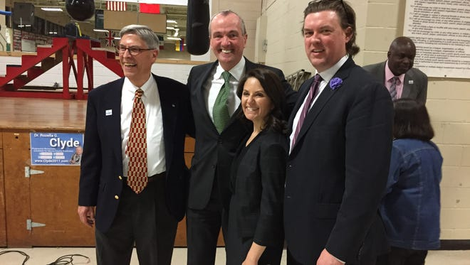 Phil Murphy, second from left,with District 25 legislative candidates Tom Moran, left, Lisa Bhimani and Richard Corcoran, at the Parsippany PAL building during the annual Morris County Democratic Committee convention March 21, 2017