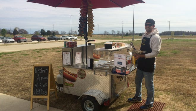 Perry's Hot Dog Hut operator Brandon Perry at his hot dog stand at Pacific Manufacturing, Tennessee Inc. on Thursday.