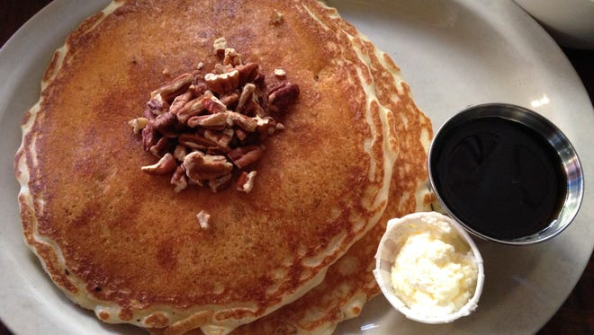 The signature pancakes are dense but not heavy, rich and delicious, served here with toasted Georgia pecans.