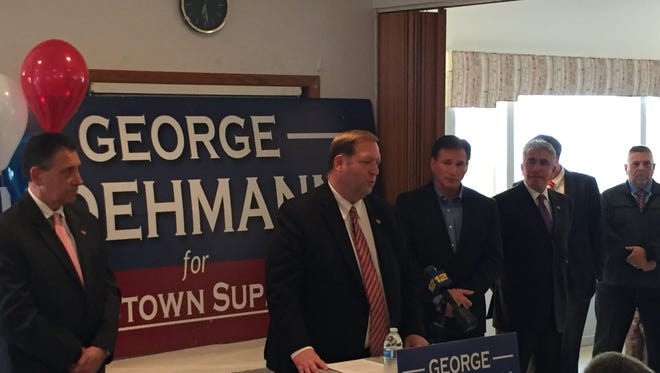 While flanked by town and county officials, Republican Supervisor George Hoehmann, center, announces he will seek re-election at the Veterans Memorial Association building in Congers on March 27, 2017.