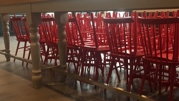 Red Windsor chairs await the museum's first guests.