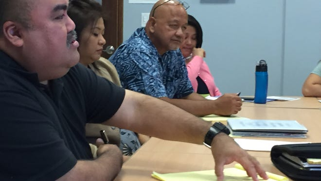 Education Deputy Superintendent Joe Sanchez gestures as he talks about textbook funding with Guam Education Board members Wednesday.