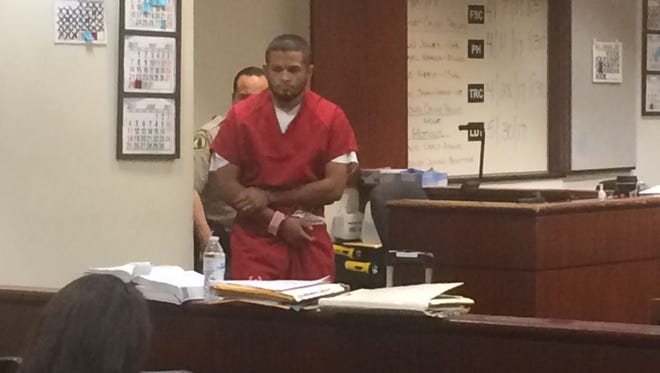 Christian Pacheco enters a Riverside County Superior Courtroom Thursday for his arraignment. He pleaded not guilty to accusations he set a mobile home on fire and killed his girlfriend and a dog on March 18.
